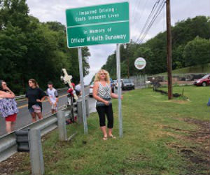 Tina Thomas at Keith Dunaway Memorial Sign