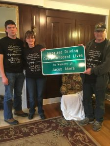 Jacob Akers sign with family