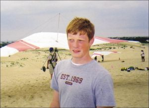 Jed Bulla with hang gliders in back