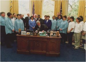 Millie with President Clinton signing .08 law