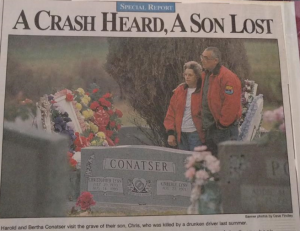 parents at gravesite in 1994v