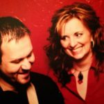 Michael and Melinda Campbell with red background