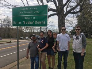 Dallas Downs' family with sign