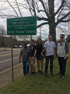 Dallas Downs' family with sign vertical