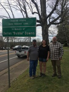 Parents and county mayor with sign