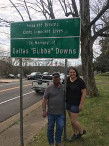 William and Michelle Schmidt with sign