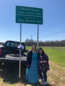 Vicki Kirk and Donna Garner with highway sign