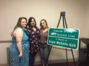 Vicki, Donna, and Kara with sign