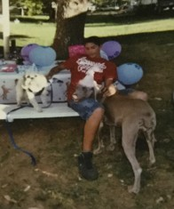 Raymond and dog at party