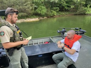 TWRA officers Hetland and Norman demonstrate seated battery SFST
